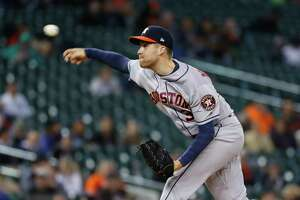 Houston Astros relief pitcher Collin McHugh throws in the seventh inning of a baseball game against the Detroit Tigers in Detroit, Tuesday, May 14, 2019. (AP Photo/Paul Sancya)