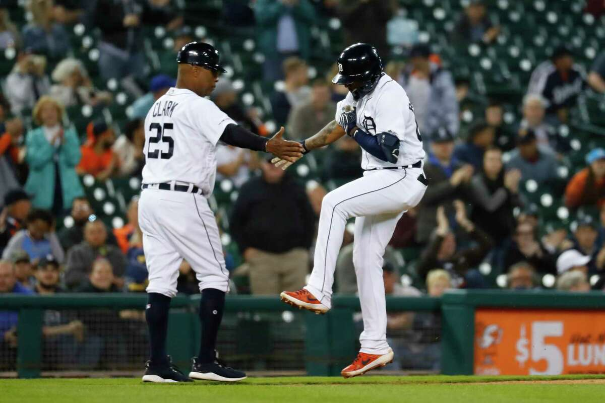Detroit Tigers' Ronny Rodriguez celebrates his two-run home run with third base coach Dave Clark (25) in the sixth inning of a baseball game against the Houston Astros in Detroit, Tuesday, May 14, 2019. (AP Photo/Paul Sancya)