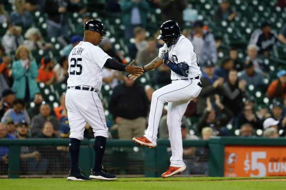 Detroit Tigers' Ronny Rodriguez celebrates his two-run home run with third base coach Dave Clark (25) in the sixth inning of a baseball game against the Houston Astros in Detroit, Tuesday, May 14, 2019. (AP Photo/Paul Sancya) Photo: Paul Sancya, Associated Press / Copyright 2019 The Associated Press. All rights reserved