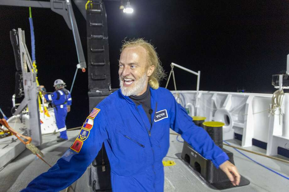In this photo provided by Atlantic Productions for Discovery Channel, Victor Vescovo emerges from his submersible 'Limiting Factor' after a successful dive to the deepest known point in the Mariana Trench, April 28, 2019. Vescovo, a businessman and amateur pilot, has also traversed the highest peaks of mountains, including Mount Everest. (Tamara Stubbs/Atlantic Productions for Discovery Channel via AP) Photo: Tamara Stubbs, Associated Press