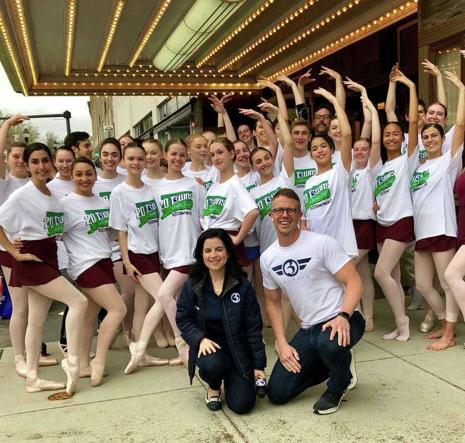 Nutmeg Ballet dancers and ballet master Tim Melady, in the rear, pose with WFSB Channel 3 personalities Melissa Cole and Mark Dixon outside the Warner Theatre after appearing on a '20 Towns in 20 Days' segment May 3, 2019. The dancers will perform on the Warner's main stage May 16, 17 and 18, 2019, in 'Dance Jubilee.' Photo: Victoria Mazzarelli / Contributed Photo