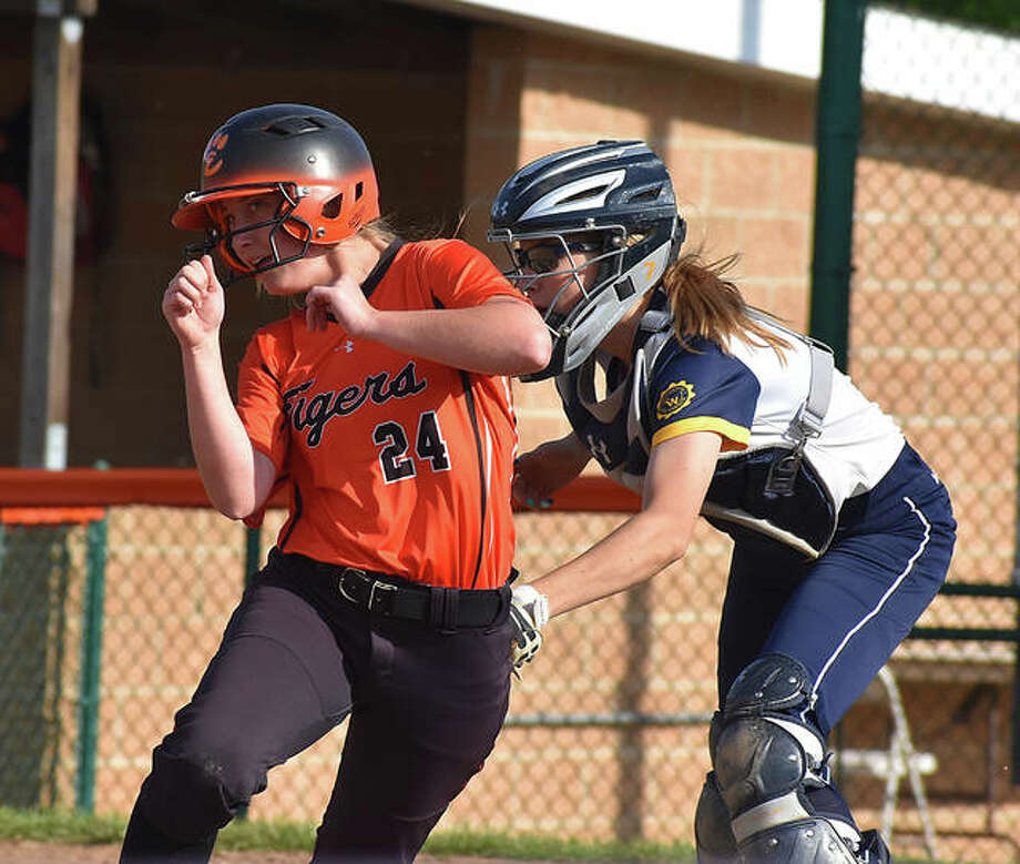 Edwardsville's Maci McNamee is tagged out at home plate in the fifth inning in Tuesday's game against O'Fallon. Photo: Matt Kamp/The Intelligencer