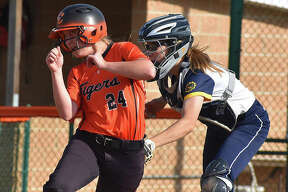 Edwardsville's Maci McNamee is tagged out at home plate in the fifth inning in Tuesday's game against O'Fallon.