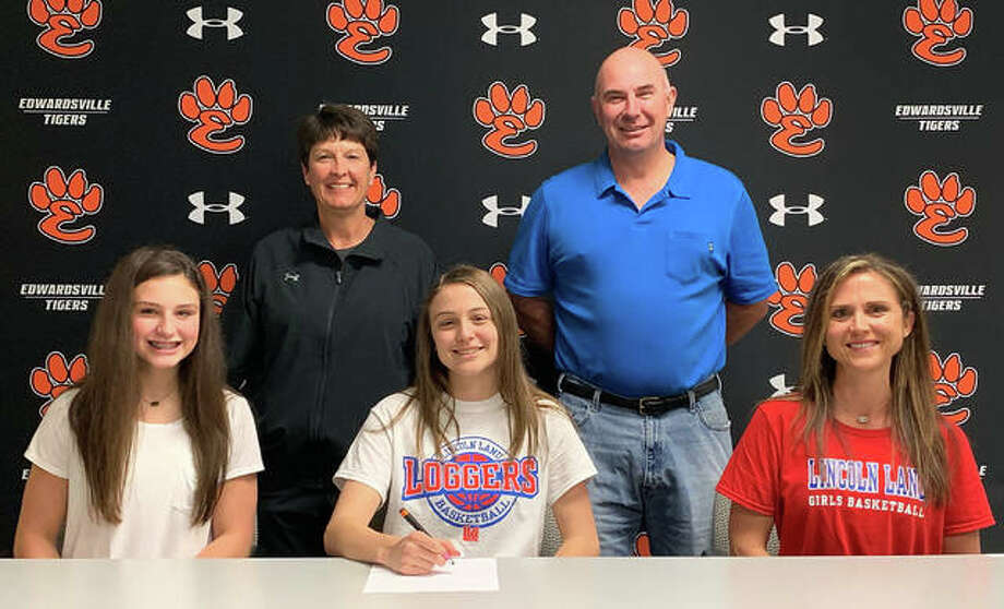 EHS senior Megan Silvey, seated center, will play women's college basketball for Lincoln Land Community College in Springfield. Photo: Matt Kamp/The Intelligencer