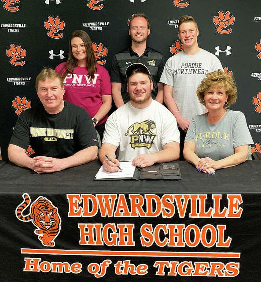 Edwardsville senior Connor Hinterser, seated center, will play college hockey for Purdue Northwest. Photo: Matt Kamp/The Intelligencer