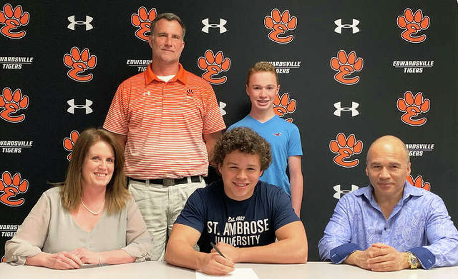 Edwardsville senior Brendan Latham, seated center, will play college football for St. Ambrose. Photo: Matt Kamp/The Intelligencer