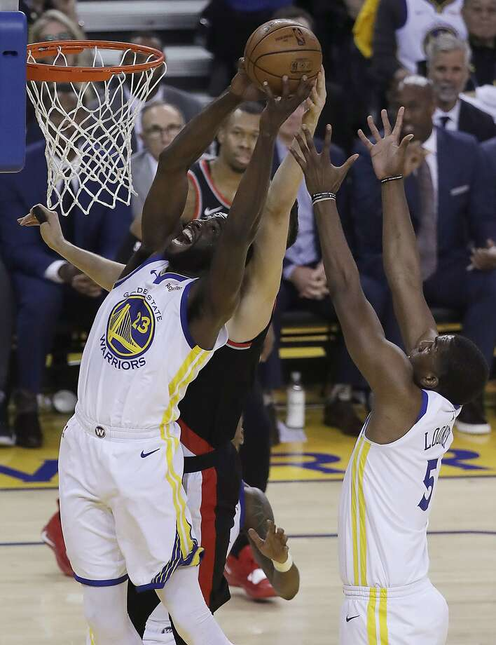 Golden State Warriors forward Draymond Green (23) grabs a rebound against the Portland Trail Blazers during the first half of Game 1 of the NBA basketball playoffs Western Conference finals in Oakland, Calif., Tuesday, May 14, 2019. (AP Photo/Jeff Chiu) Photo: Jeff Chiu, Associated Press