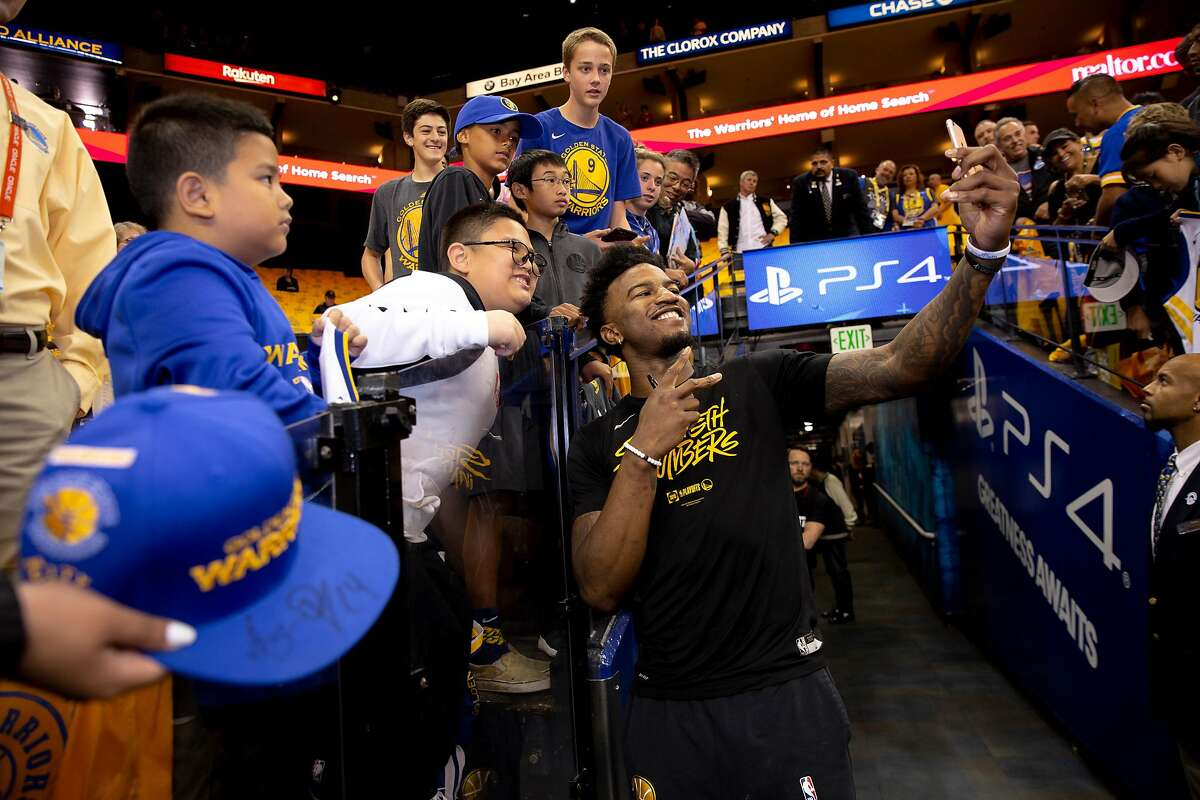 Jordan Bell takes a selfie with a fan during the 2019 playoffs. After a chaotic two years, he's back.