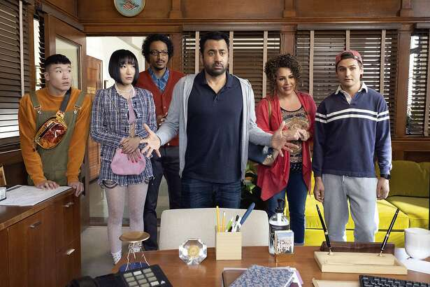 "This image released by NBC shows, from left, Joel Kim Booster, Poppy Liu, Samba Schutte, Kal Penn, Diana Marie Riva and Moses Storm in a scene from ""Sunnyside."" On Thursday night, where NBC sitcoms including ""Cheers"" and ""Friends"" ruled back in the 1980s and '90s, the network will introduce newcomers ""Perfect Harmony"" and ""Sunnyside"" to join returning comedies ""Superstore"" and ""The Good Place"" this fall. (Photo by: Colleen Hayes/NBC)"