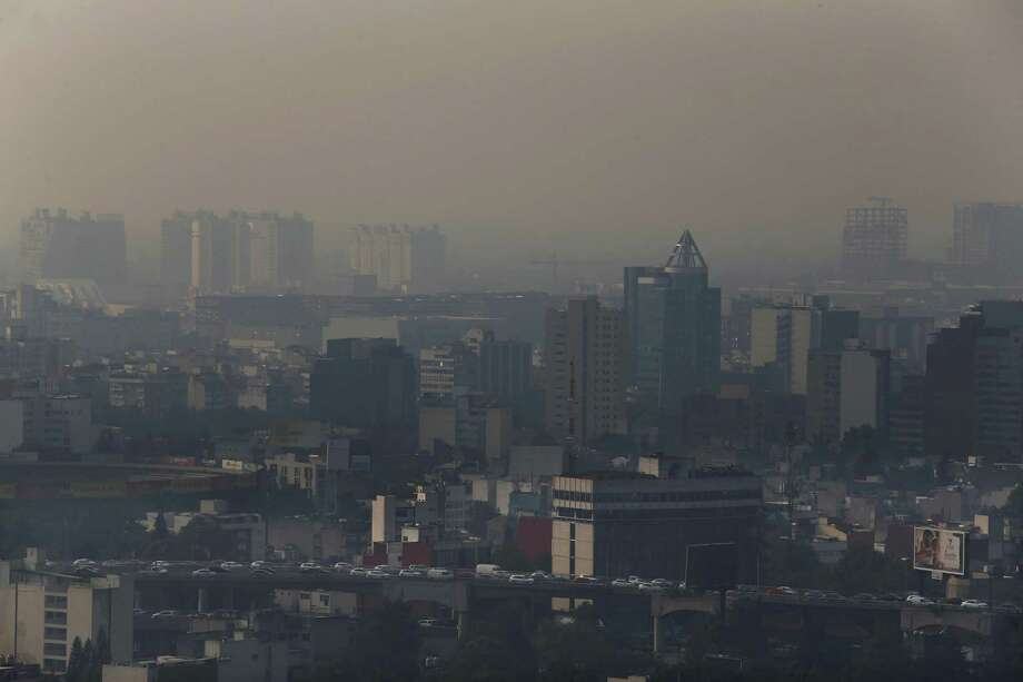 Smoke hangs over in Mexico City, Monday, May 13, 2019. Mexico City's government has warned residents to remain indoors as forest and brush fires carpeted the metropolis in a smoky haze that has alarmed even many of those accustomed to living with air pollution. (AP Photo/Marco Ugarte) Photo: Marco Ugarte, STF / Associated Press / Copyright 2019 The Associated Press. All rights reserved.