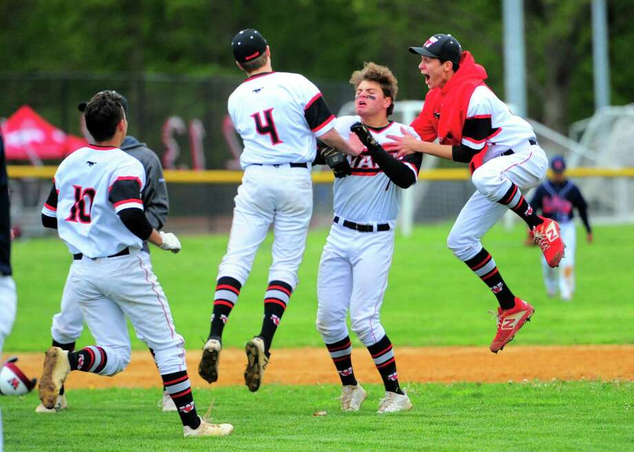 Fairfield Warde celebrates its 3-2 win over Brien McMahon on Tuesday in Fairfield. Sam Vincent hit a walk-off double in the bottom of the seventh inning to give Warde the victory. Photo: Christian Abraham / Hearst Connecticut Media / Connecticut Post