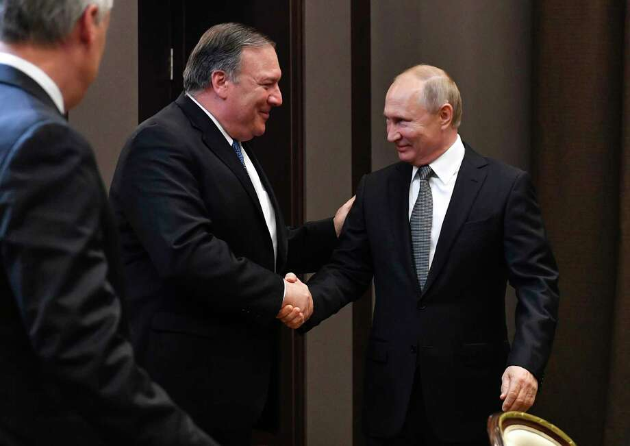 Russian President Vladimir Putin, second right, and U.S. Secretary of State Mike Pompeo, second left, greet each other prior to their talks in the Black Sea resort city of Sochi, southern Russia, Tuesday, May 14, 2019. Pompeo arrived in Russia for talks that are expected to focus on an array of issues including arms control and Iran. (Alexander Nemenov/Pool Photo via AP) Photo: Alexander Nemenov / Copyright 2019 The Associated Press. All rights reserved