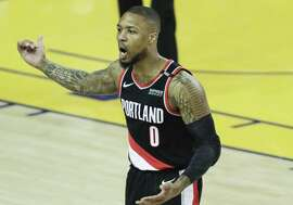 Portland Trail Blazers Damian Lillard argues a call in the first quarter during game 1 of the Western Conference Finals between the Golden State Warriors and the Portland Trail Blazers at Oracle Arena on Tuesday, May 14, 2019 in Oakland, Calif.
