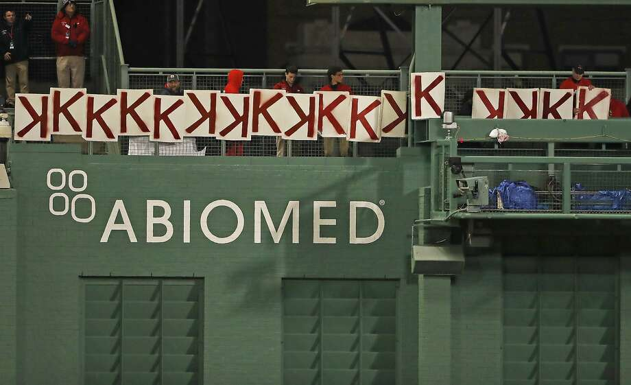 Fans at Fenway Park document the 17 strikeouts by Boston's Chris Sale, besting his career high of 15. Photo: Winslow Townson / Associated Press