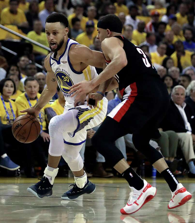 Golden State Warriors' Stephen Curry, left, drives the ball against his brother, Portland Trail Blazers' Seth Curry, during the first half of Game 1 of the NBA basketball playoffs Western Conference finals Tuesday, May 14, 2019, in Oakland, Calif. (AP Photo/Ben Margot) Photo: Ben Margot / Copyright 2019 The Associated Press. All rights reserved.