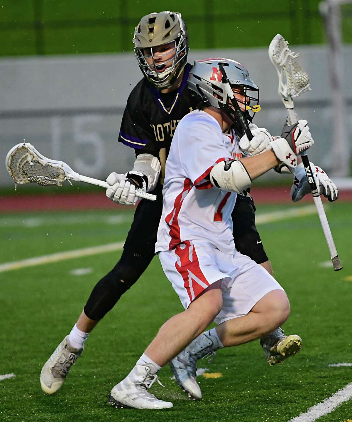 With a broken stick, Christian Brothers Academy's Jon Rollo defends Niskayuna's Gabe Nish during a lacrosse game on Frank Bailey Field at Union College on Tuesday, May 14, 2019 in Schenectady, N.Y. (Lori Van Buren/Times Union)