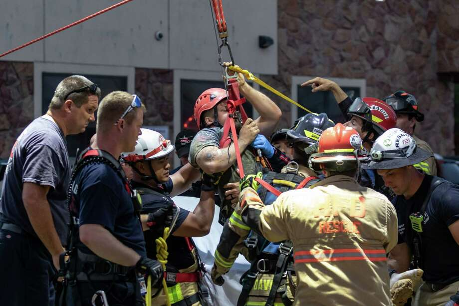 Firefighters from the The Woodlands, Klein, Spring, and Houston Fire Departments worked for nearly 5 hours to free a man trapped in a trench on Tuesday, May 14, 2019, in Klein, Texas. Photo: Joe Buvid, Contributor / © 2019 Joe Buvid