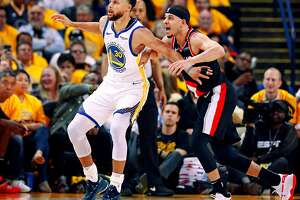 Golden State Warriors Stephen Curry and Portland Trail Blazers Seth Curry are seen in the second quarter during game 1 of the Western Conference Finals between the Golden State Warriors and the Portland Trail Blazers at Oracle Arena on Tuesday, May 14, 2019 in Oakland, Calif.