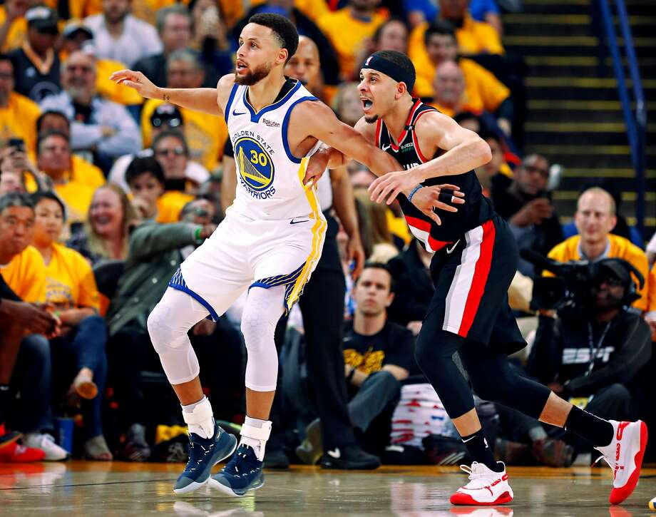 Golden State Warriors Stephen Curry and Portland Trail Blazers Seth Curry are seen in the second quarter during game 1 of the Western Conference Finals between the Golden State Warriors and the Portland Trail Blazers at Oracle Arena on Tuesday, May 14, 2019 in Oakland, Calif. Photo: Scott Strazzante, The Chronicle