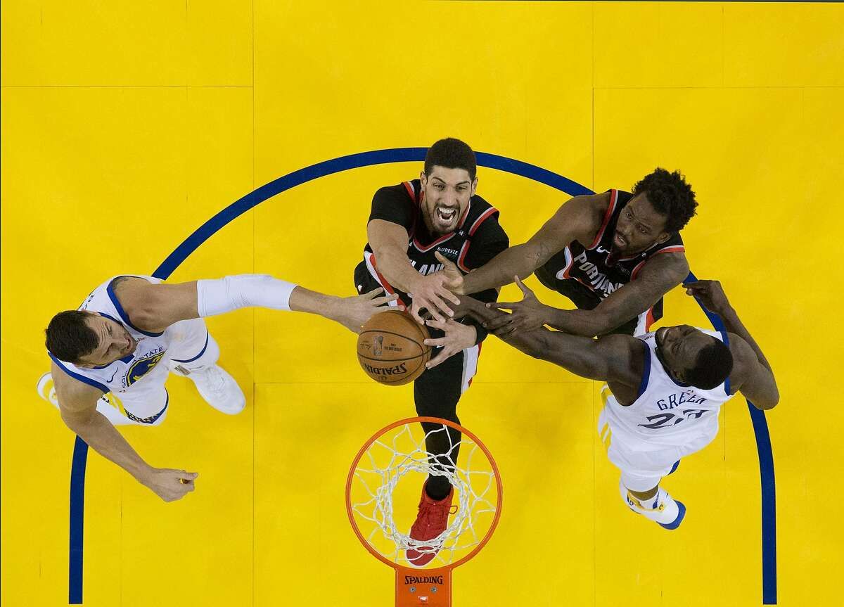 Enes Kanter (00) and Al-Farouq Aminu (8) try to get a rebound ahead of Draymond Green (23) and Andrew Bogut (12) in the first half as the Golden State Warriors played the Portland Trailblazers in Game 1 of the Western Conference Finals at Oracle Arena in Oakland, Calif., on Tuesday, May 14, 2019.