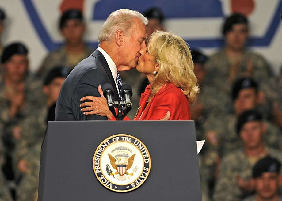 Vice President Joe Biden kisses his wife, Jill Biden, before he addresses the troops at Fort Drum. (Lori Van Buren / Times Union) Photo: LORI VAN BUREN