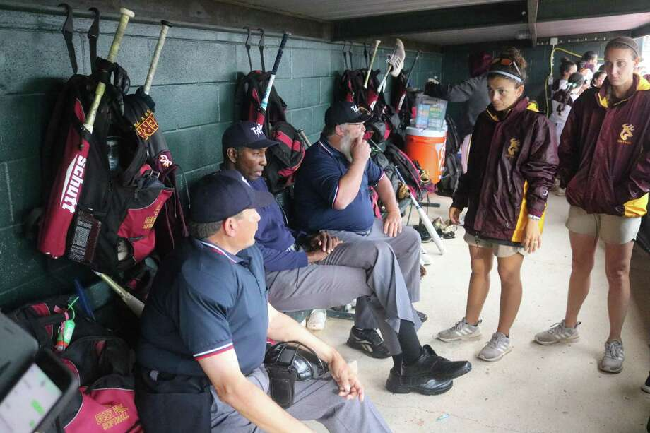 Deer Park head coach Errica Cantu and assistant coach Katie Schaefer discus the topic of weather with the umpires in the Madisonville High School dugout Saturday night during a rain delay at the start of the game. Photo: Robert Avery