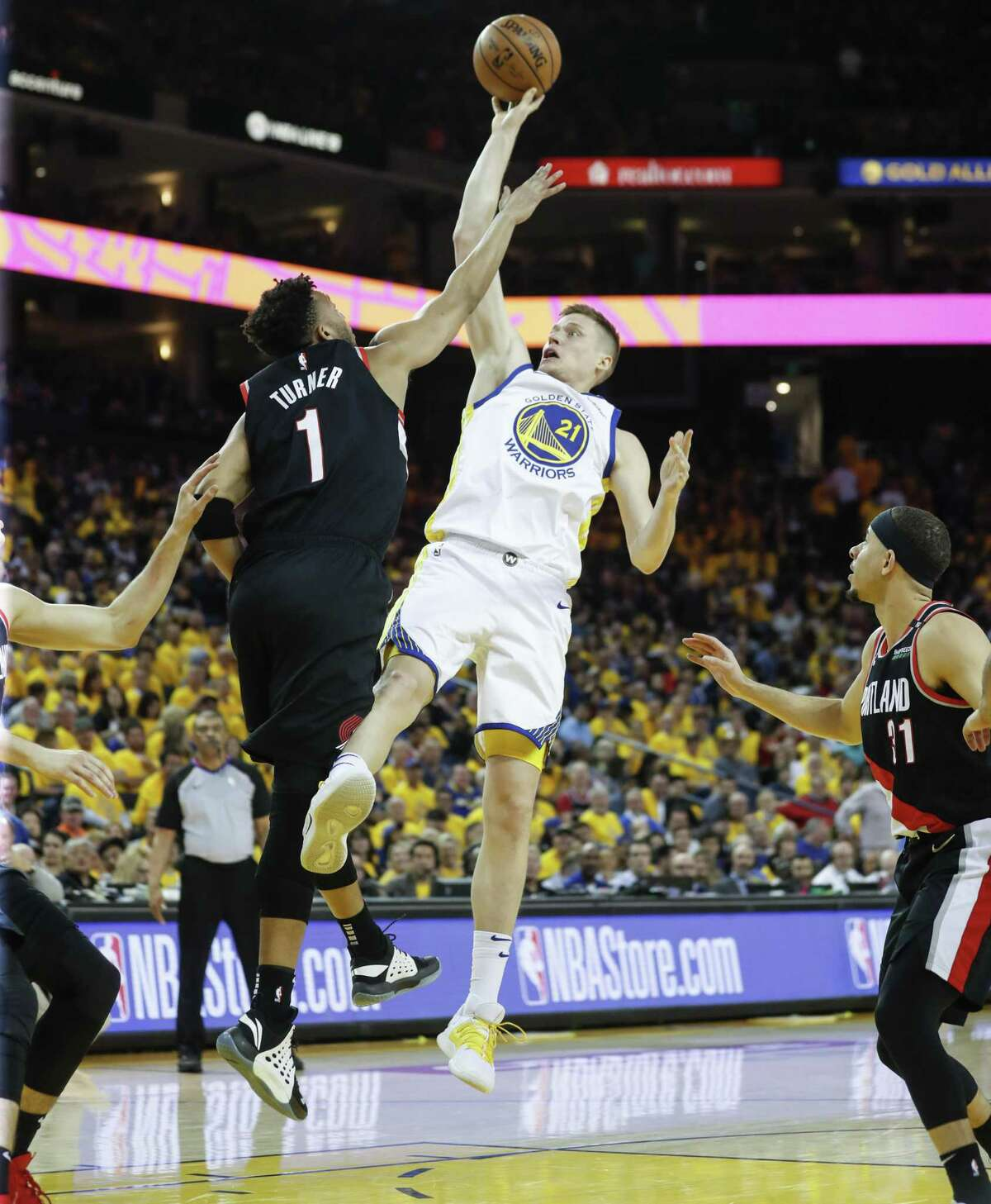 Golden State Warriors Jonas Jerebko shoots over Portland Trail Blazers Evan Turner in the fourth quarter during game 1 of the Western Conference Finals between the Golden State Warriors and the Portland Trail Blazers at Oracle Arena on Tuesday, May 14, 2019 in Oakland, Calif.