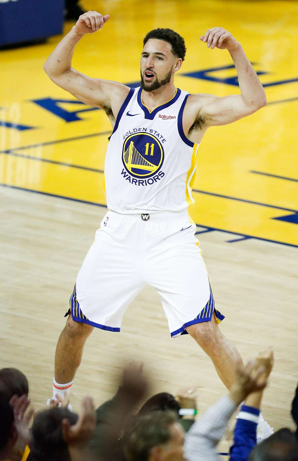 Golden State Warriors Klay Thompson reacts after dunking in the fourth quarter during game 1 of the Western Conference Finals between the Golden State Warriors and the Portland Trail Blazers at Oracle Arena on Tuesday, May 14, 2019 in Oakland, Calif.