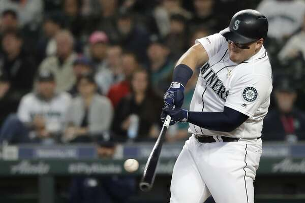 Seattle Mariners' Daniel Vogelbach hits a solo home run during the second inning of the team's baseball game against the Oakland Athletics, Tuesday, May 14, 2019, in Seattle. (AP Photo/Ted S. Warren)