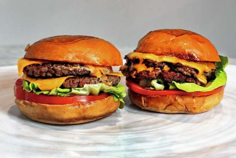 An Original Impossible Burger (left) and a Cali Burger from Umami Burger are hard to tell apart from a beef burger just y looking. A new era of meat alternatives is here, with Beyond Meat becoming the first vegan meat company to go public and Impossible Burger popping up on menus around the country. Photo: Richard Drew | Associated Press