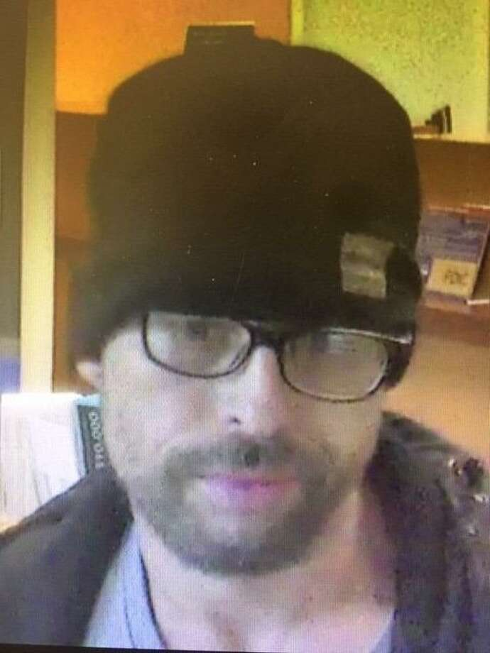 This suspect is wanted by State Police in connection with the robbery of Liberty Bank at 127 South Main Street in Beacon Falls on Tuesday, May 14, 2019. The suspect is described as a light-skinned Hispanic male wearing a dark-colored North Face brand jacket, a dark-colored knit-style cap and eyeglasses. This suspect is reported to have entered the bank and demanded money from a teller. Photo: State Police Photo