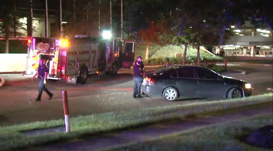 Police investigate a shooting in northwest Houston  that left a man hospitalized Wednesday, May 15, 2019.  A security guard found the man laying on the side of the road. Photo: Metro Video