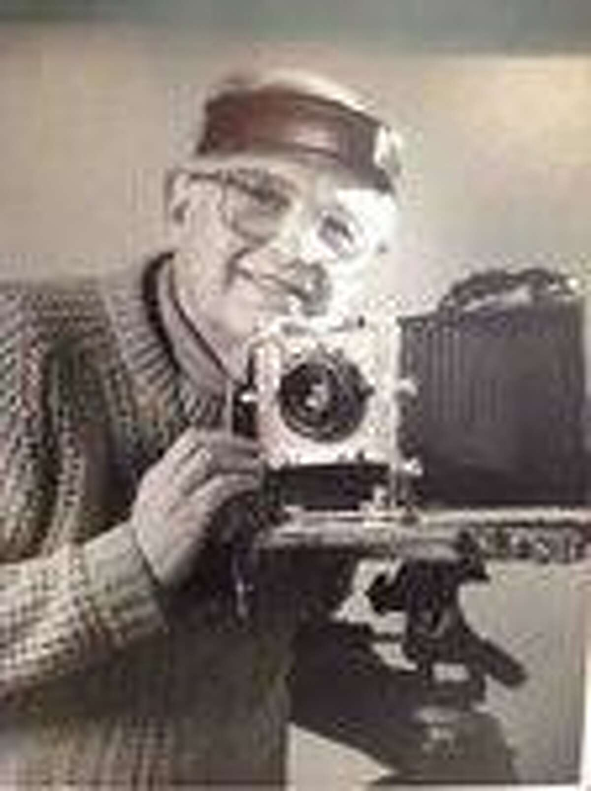 Harry Cohen was a supporter of the arts, including theater and photography, in the New Milford community. Cohen is shown above with one of his cameras.