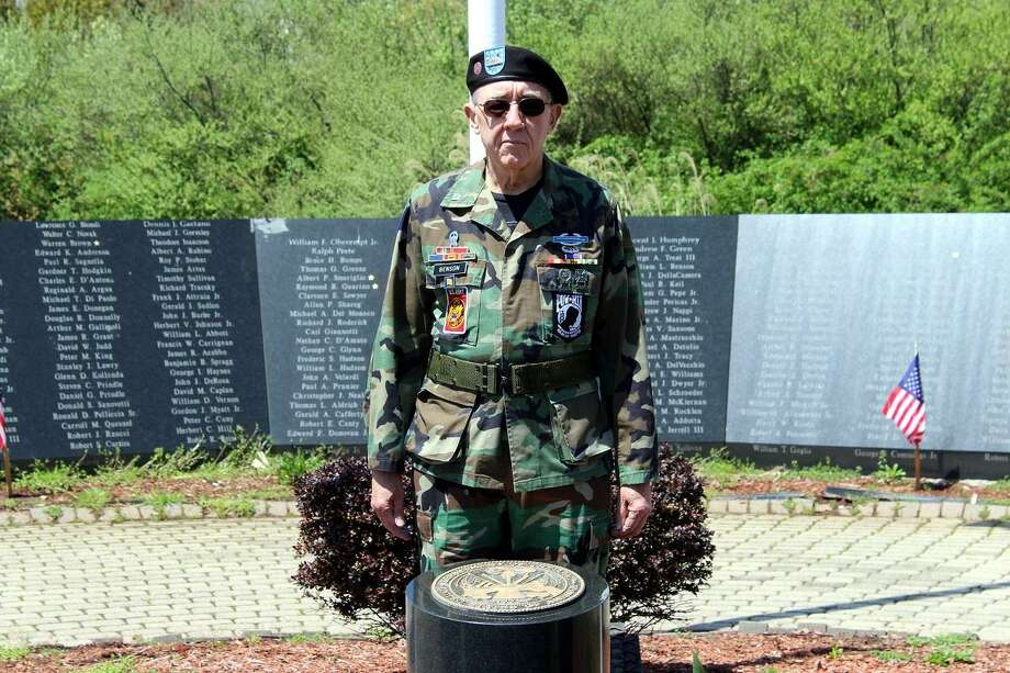 "William ""Bill"" Benson, a longtime member and former president of West Haven Vietnam Veterans, stands behind the granite U.S. Army insignia marker May 6 at the Vietnam Veterans Memorial in Bradley Point Park. Photo: Photo Provided By Michael Walsh /"