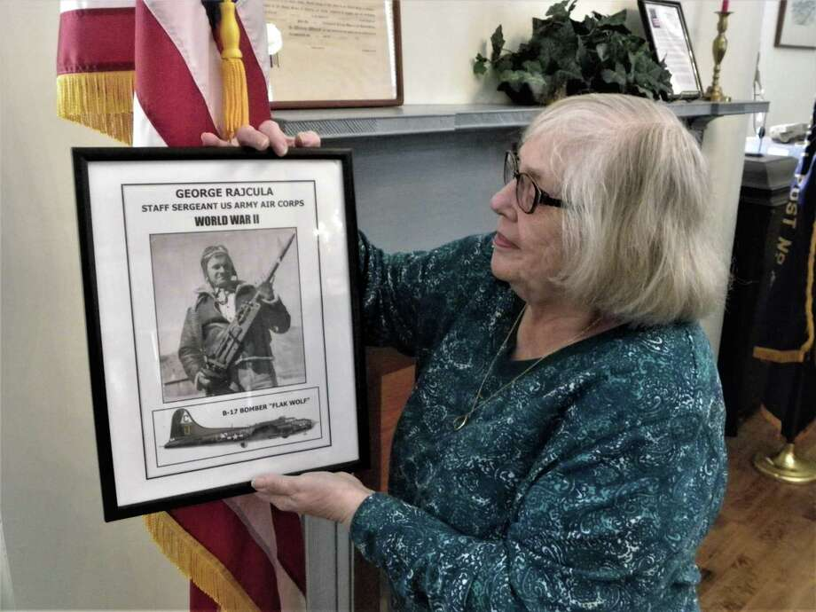 Elaine Rajcula, of Brookfield, holds photograph of her brother-in-law, Staff Sgt. George Rajcula, who was killed in World War II while on a bombing mission over Germany. His story is part of a Memorial Day exhibit honoring the memory of 44 former Brookfield residents killed in military action. Photo: / Contributed Photo