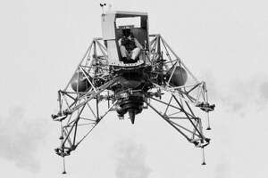 Inflight view of Astronaut Neil Armstrong flying the Lunar Landing Training Vehicle (LLTV) at EAFB. EAFB, Houston, TX