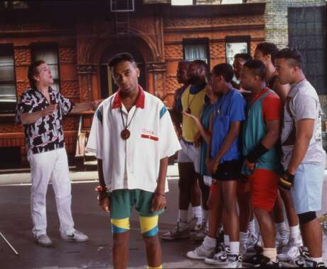 Portrait of American film director and actor Spike Lee (center) on the set of his film 'Do the Right Thing,' New York, 1989. Among the cast behind him is actor Danny Aiello (left). (Photo by Anthony Barboza/Getty Images)