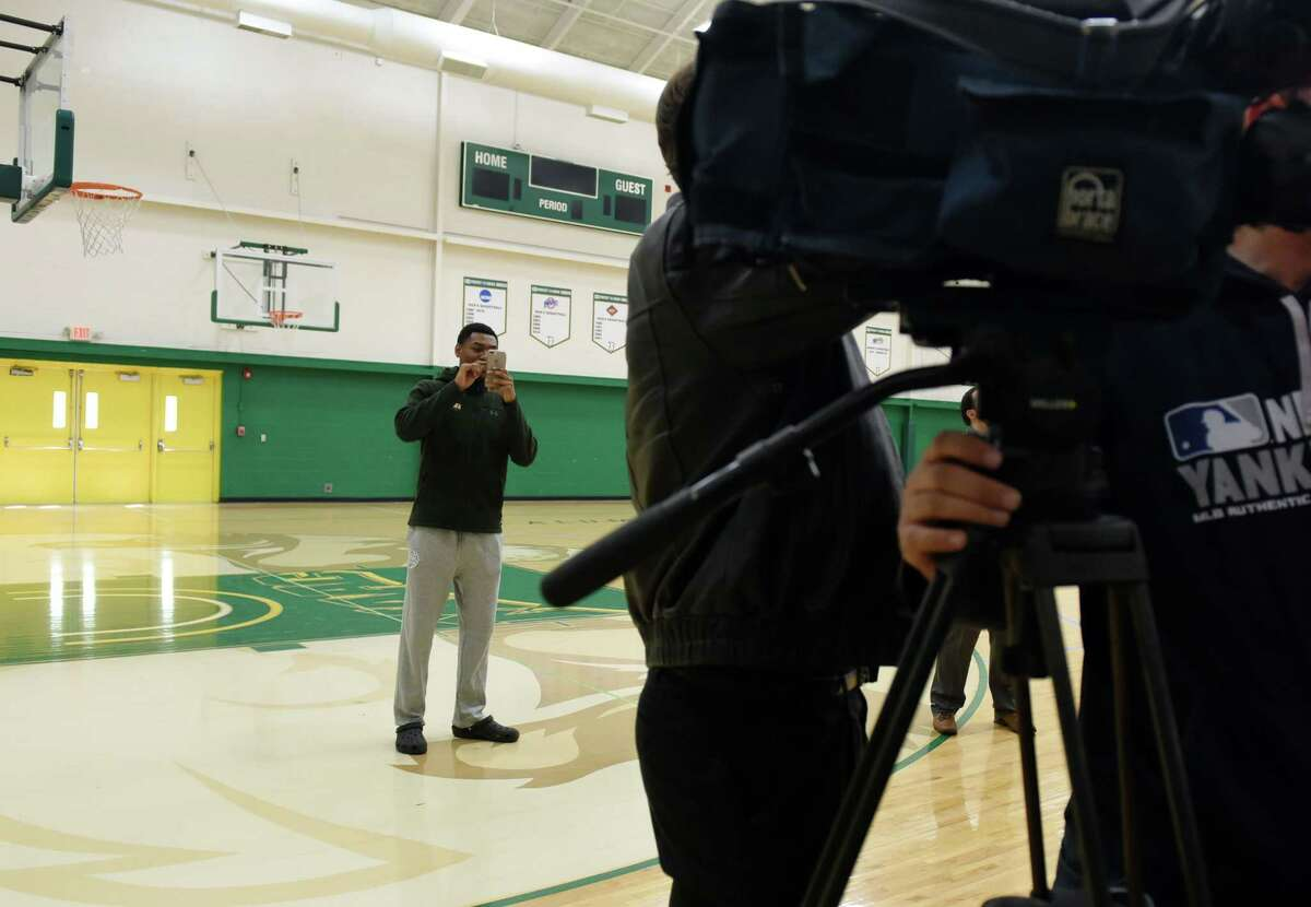 Siena men's basketball guard Jalen Pickett takes a picture of head coach Carmen Maciariello as he speaks to the media on Wednesday, May 15, 2019 at Siena College in Loudonville, NY. (Phoebe Sheehan/Times Union)