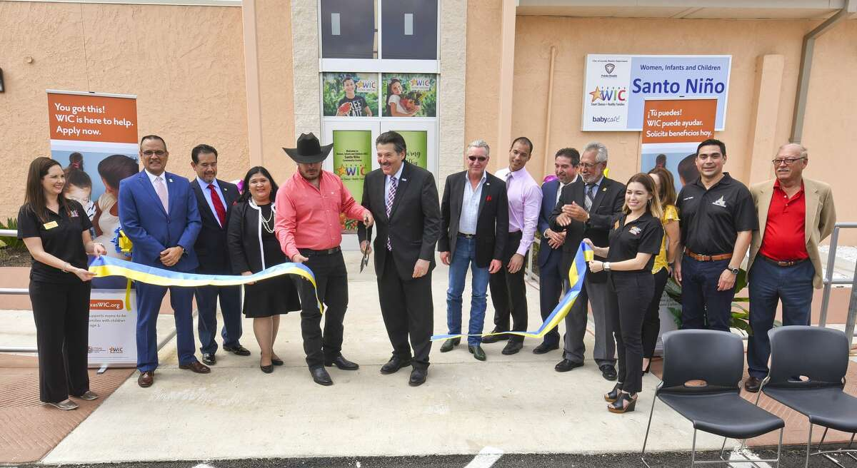 City officials and directors that contributed to the project, perform a ribbon cutting as they inaugurate the Women, Infants and Children Santo Niño Community Center, Tuesday, May 14, 2019, in South Laredo.