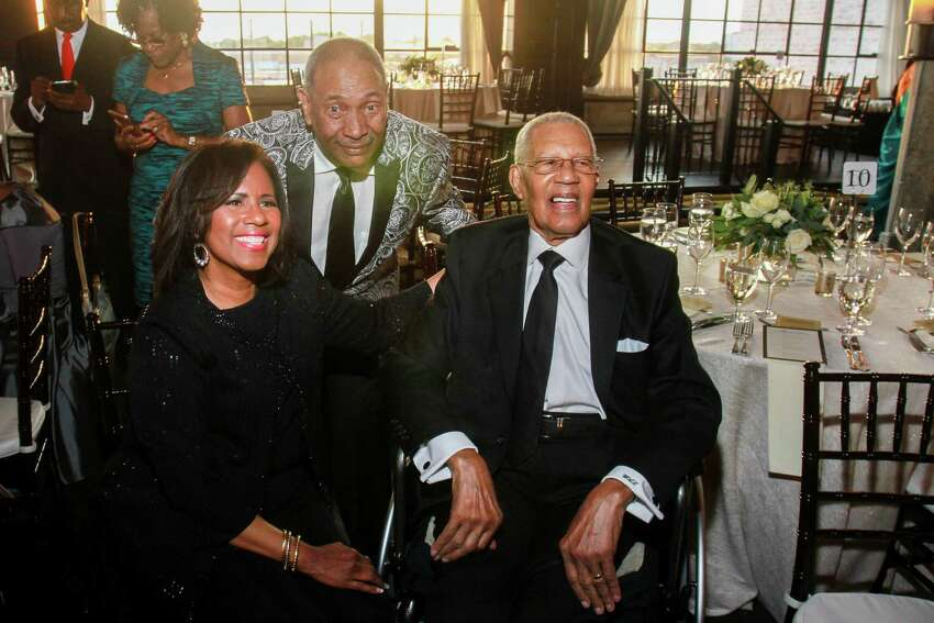Melanie Lawson and John Guess, from left, with her father, Rev. William Lawson at Rothko Chapel's Illumination Gala.