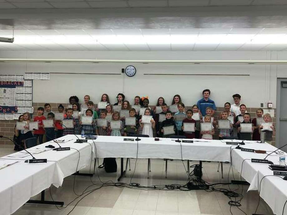 Edwardsville District 7 Board of Education announced May's Do The Right Thing Award winners Monday during its regular board meeting. Students recognized are: Lauren Hangsleben, Bryson Maedge, Usma Risvi, Lane Kubarick and Tara Colligan; Ellie Bozarth, Madison Kolakowski and Joe Viox from Lincoln Middle School; Julia Grimm, Kylie Johnson and Kylie Grist from Liberty Middle School' Layne Nichols, Davis Clark and Blanca Sarabia from Worden Elementary; Eli Weems, Estelle Donsbach and Brady Cheek from Woodland Elementary; Samantha Gray, Avery Marsh and Hannah Stahlheber from Columbus Elementary; Parker LeVasseur, Alex Martin and Grace Jackson from Cassens Elementary; Alexander Haskell, Maddy Thomas and Grayson Dittman from Glen Carbon Elementary; Jaxson Parise, Gavin Galligan, McKenna Bartley and Aiden Dickerson from Leclaire Elementary; Maddox Lackey, Ava Sauerwein and Noah Mills from Hamel Elementary; Scarlett Battuello, Noah Thompson and Madison Alexander from Midway Elementary; Ean Glass, Andrew Nativi and Ishpreet Bawa from Nelson Elementary and Solomon Ahart, Caroline Zhao and Uriel Fuentes from Goshen Elementary. Photo: Julia Biggs | The Intelligencer