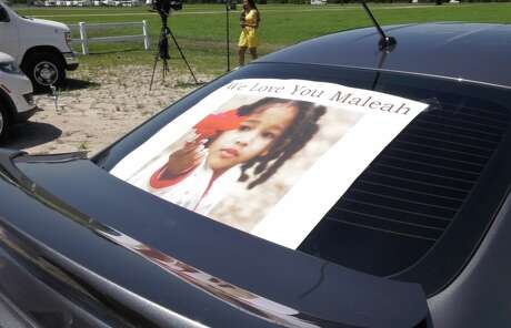 "A sign reading ""We Love You Maleah"" is seen on the back of Celeste Johnson's car during the search for missing 4-year-old Maleah Davis on Wednesday, May 15, 2019."