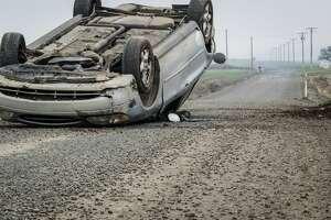 car crash car flipped generic stock photo