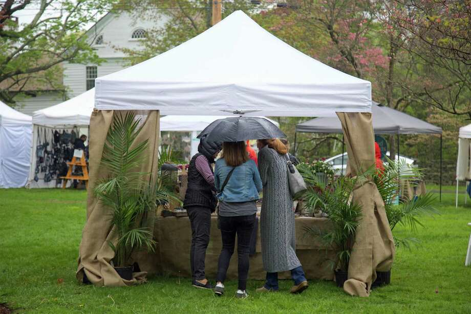 As the rain picked up, umbrellas came out at the 84th annual Dogwood Festival at Greenfield Hill Congregational Church on Friday, May 10, 2019, in Fairfield, Conn. Photo: Jarret Liotta / For Hearst Connecticut Media / Fairfield Citizen News Freelance