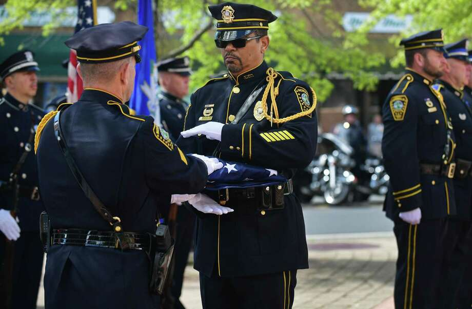 Police honor guard retire the colors as The Norwalk Police Department and their guests honor fallen officers Wednesday, May 15, 2019, during their annual Memorial Service at police headquarters in Norwalk, Conn. Photo: Erik Trautmann / Hearst Connecticut Media / Norwalk Hour