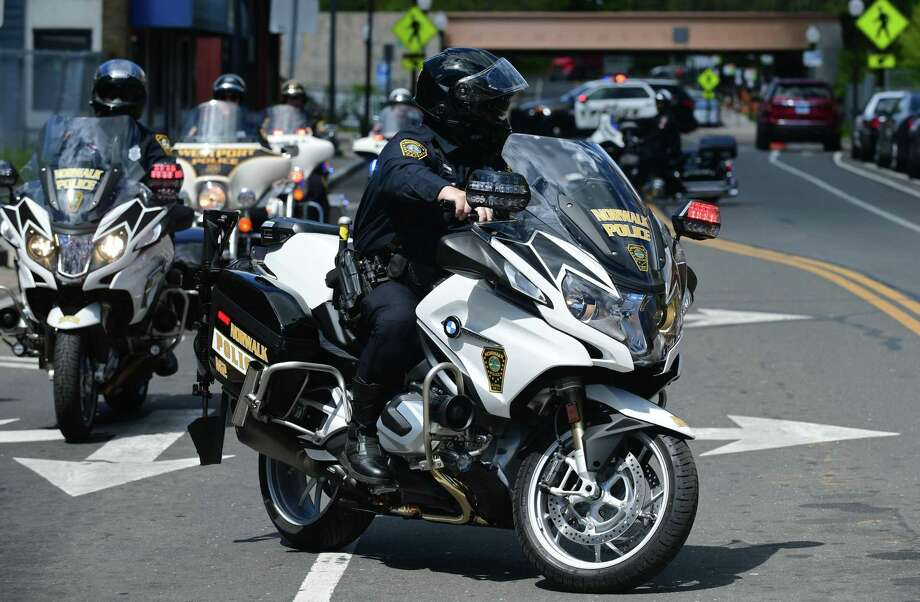 Norwalk Motocycle Police lead a procession of Motorcycle Police from surrounding communities as The Norwalk Police Department and their guests honor fallen officers Wednesday, May 15, 2019. Photo: Erik Trautmann / Hearst Connecticut Media / Norwalk Hour