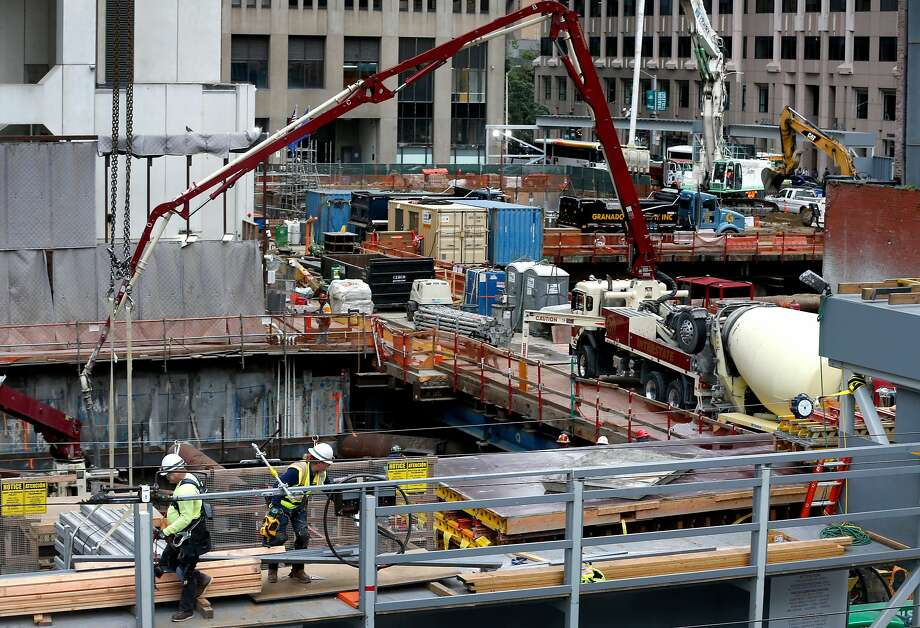 Construction of the Oceanwide Center office tower at First and Mission streets continues in San Francisco Tuesday. Sources say the project is seeking more funding. Photo: Paul Chinn / The Chronicle