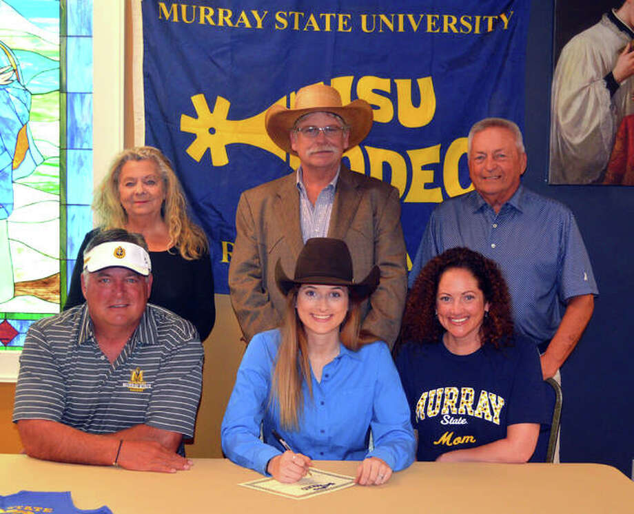 Father McGivney senior Faith Robbins, seated middle, will compete in rodeo at Murray State University. She is joined by her family and Murray State coach JD VanHooser. Photo: Scott Marion/The Intelligencer