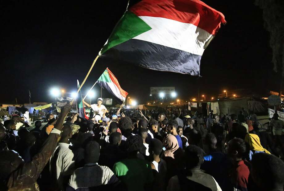 Sudanese protestors celebrate after an agreement was reached with the military council in Khartoum. Photo: Ashraf Shazly / AFP / Getty Images