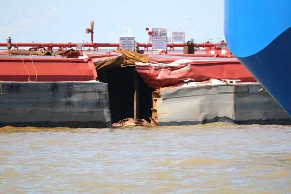 Containment boom removed around the site of the impacted barge 30015T after the remaining product was transferred to another barge on May 14, 2019, near Bayport in the Houston Ship Channel.